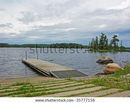 dock and boat ramp on northern lake in Voyagers national park - stock photo