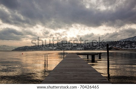 Dock and Cloudy Sky - stock photo