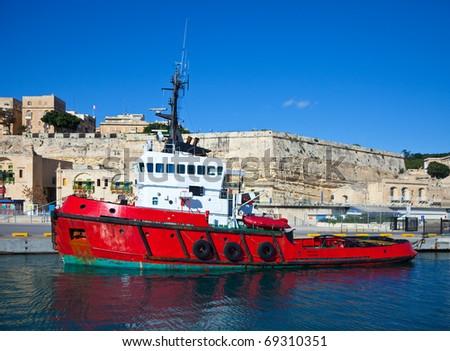 Dock boat lying at Grand harbour (Valletta, Malta) - stock photo