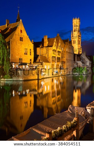 Dock of the Rosary (Rozenhoedkaai) and Belfry at twilight. A scene from a medieval fairytale in Bruges, Belgium - stock photo