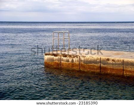 Dock off the coast of Piran, Slovenia - stock photo