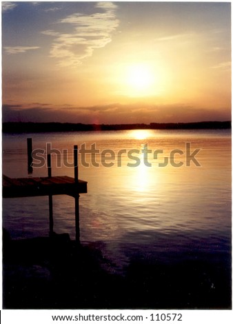 Dock on lake in Northern Michigan - stock photo