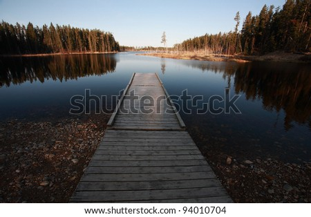 Dock on Northern Manitoba lake - stock photo