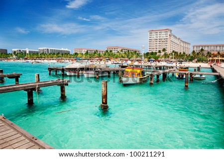 Dock on Palm Beach, Aruba on a sunny Spring afternoon - stock photo