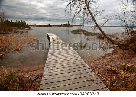 Dock on Reed Lake in Northern Manitoba - stock photo