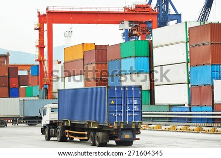 dock terminal of freight container boxes in open air cargo sea port warehouse  - stock photo