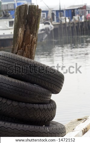 Dock tires - a scene taken on the waterfront wharfs in Portland, Maine. - stock photo
