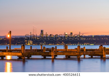 dock with background of Bellevue cityscape with reflection on lake washington at night - stock photo