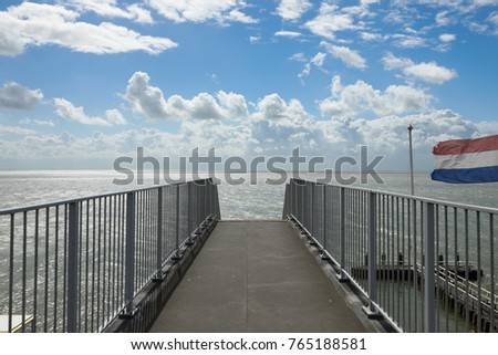 Dock with north sea during a cloudy day