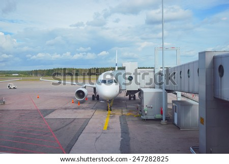 Docked aircraft in the Helsinki Airport - stock photo