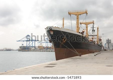 Docked container cargo ship - stock photo