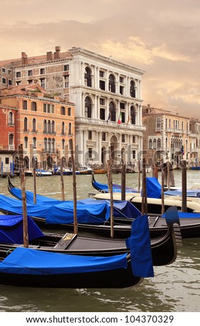 Docked Gondolas on the Grand Canal of Venice, Italy at Sunset