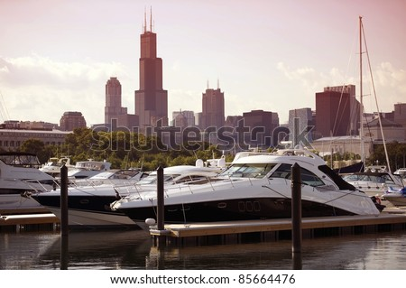 Docked Yachts at the Harbor - Downtown Chicago in the Background. Luxury Expensive Motorboats. Horizontal Photography. - stock photo