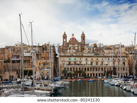 Docked yachts in Dockyard Creek of Senglea, Malta - stock photo