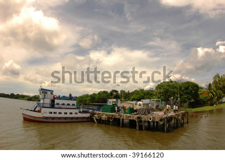 Docking a small Ferry Pier in Ometepe, Lake Nicaragua - stock photo
