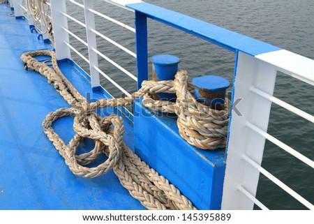 Docking rope on ferry boat - stock photo