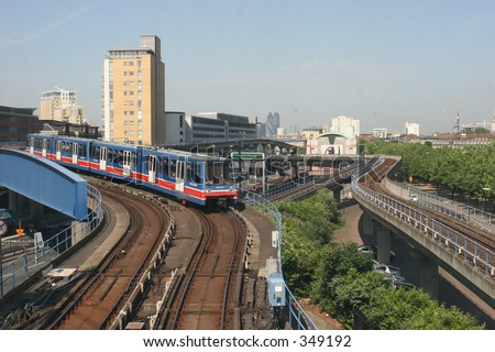 Docklands Light Railway (DLR) en route from Canary Wharf - stock photo