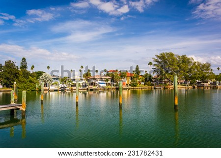 Docks and houses along Little McPherson Bayou in St. Pete Beach, Florida - stock photo