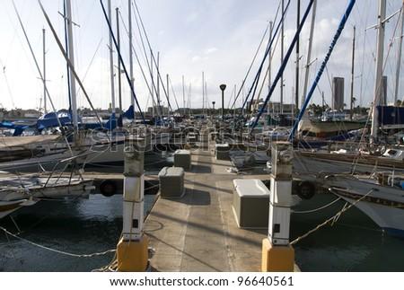 Docks in a marina full of boats in Hawaii - stock photo