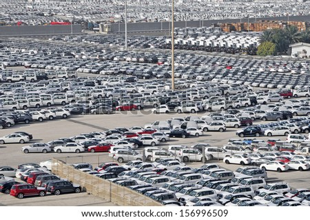 Dockside storage compounds for cars trucks and timber United Arab Emirates - stock photo
