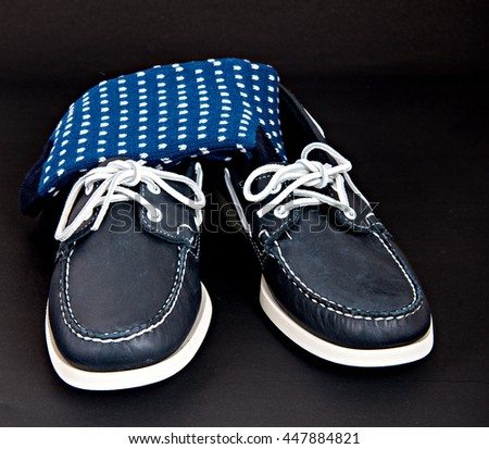 Docksides deck shoes with hand-linked toes socks