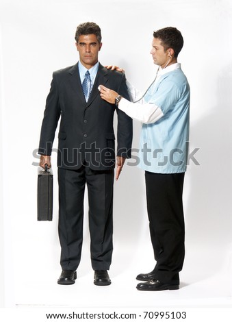 Doctor analizing an android businessman. - stock photo