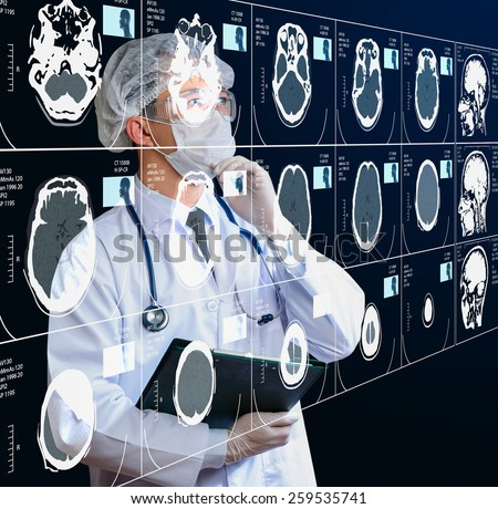 doctor analyzing CT scan result - stock photo