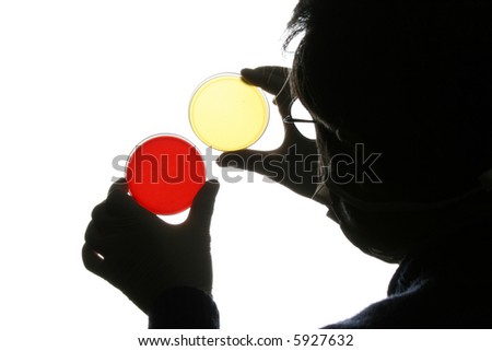 Doctor analyzing petri dish - stock photo