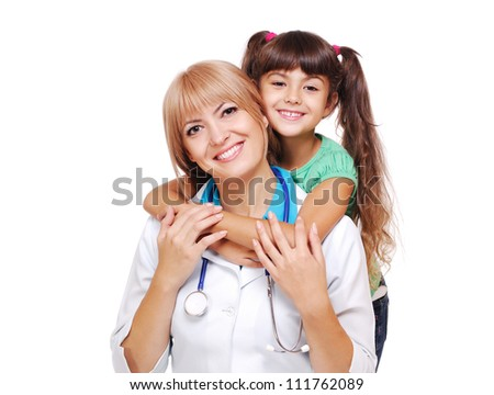 Doctor and a smiling  girl patient - stock photo