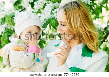 Doctor and child during spring allergic blossom dust season - stock photo