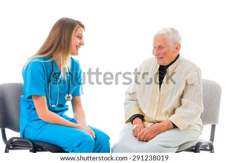 Doctor and elderly patient sitting on chairs and talking. - stock photo