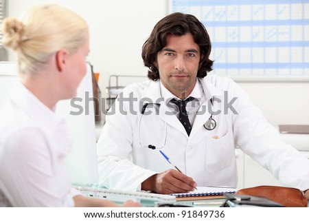 doctor and female patient at surgery