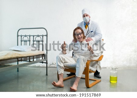 Doctor and happy patient in hospital - stock photo