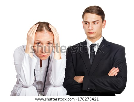 Doctor and her lawyer at a meeting for malpractice - stock photo