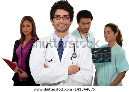 Doctor and his medical team - stock photo