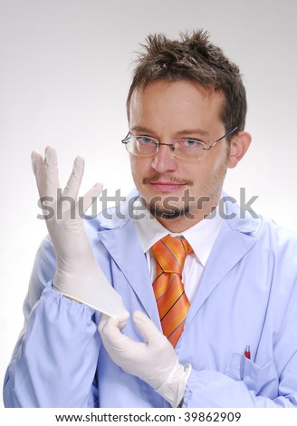 Doctor and latex gloves. A doctor putting itself a latex protective gloves. Surgery medic. - stock photo