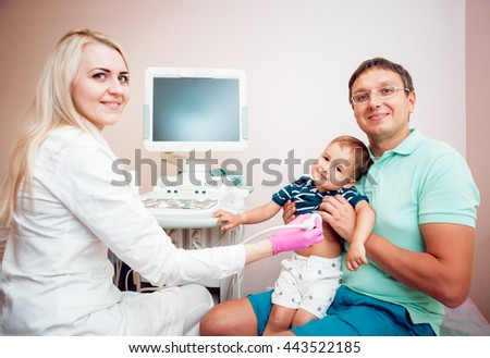 Doctor and little boy patient. Ultrasound equipment. Diagnostics. Sonography.