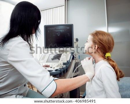 Doctor and little girl patient. Ultrasound equipment. Diagnostics. Sonography.