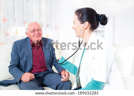 Doctor and male senior patient, home care - stock photo