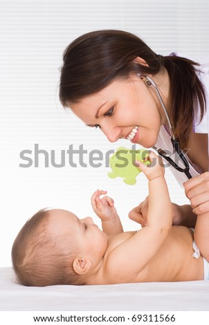 doctor and newborn on a white background - stock photo