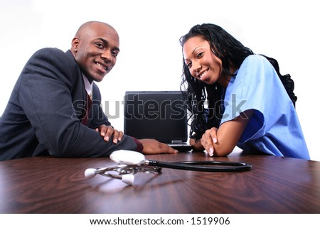 Doctor and Nurse Interacting - stock photo
