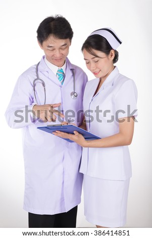 doctor and nurse reviewing medical chart, isolated on white - stock photo