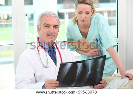 Doctor and nurse watching a radiography