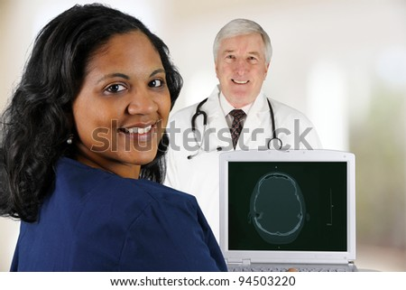 Doctor and Nurse working in a hospital - stock photo