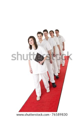 Doctor and Nurses on a red carpet isolated on white background - stock photo