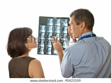Doctor and Patient Discuss MRI (Xray) Spinal Scans - stock photo