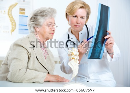 Doctor and patient discussing scan results in diagnostic center - stock photo