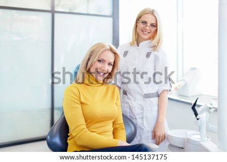 Doctor and patient in a medical clinic - stock photo
