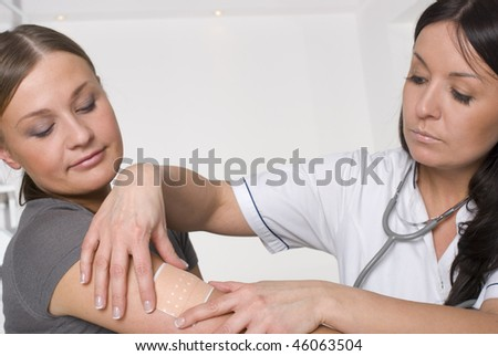 Doctor and patient in doctors off - stock photo
