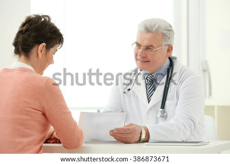 Doctor and patient in office - stock photo